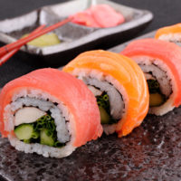 Salmon & tuna sushi roll with chopsticks