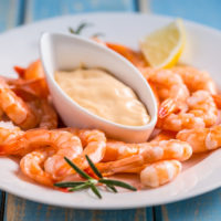 Boiled shrimps on a plate with sauce